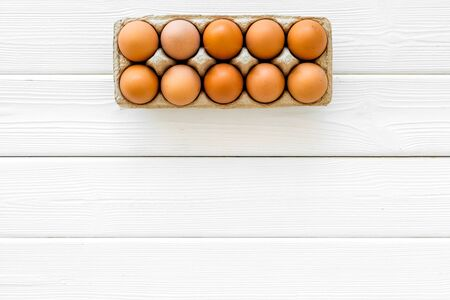 Farm products with eggs on white wooden background top view mock up