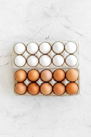 Farm products with eggs on marble background top view mock up