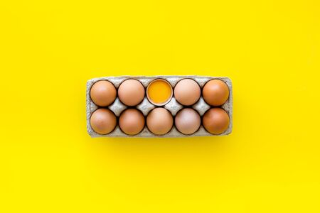 Fresh eggs for organic food on yellow background top view