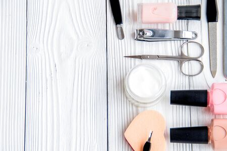 Set for manicure and make-up on wooden