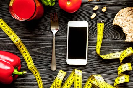 Concept diet and smartphone with vegetables mock up 写真素材