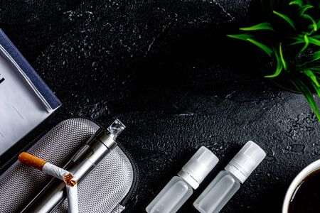 Concept of electronic cigarette on dark