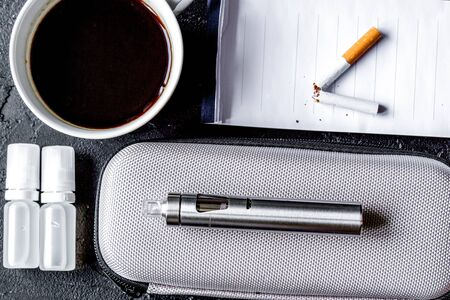 Concept of electronic cigarette on dark Stock Photo