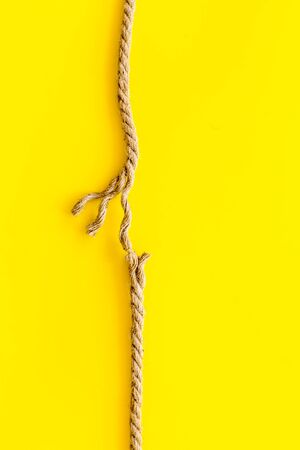 stress concept with breaking rope on yellow background top view mockup