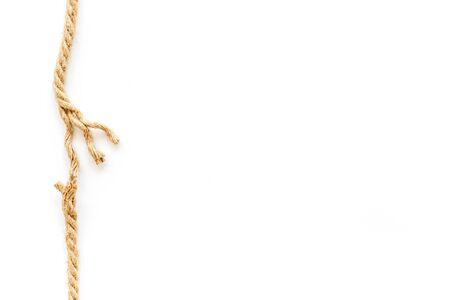 risk concept with rope near to break on white background top view space for text.