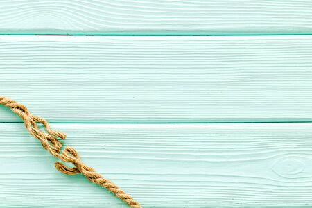 rope frame on mint green wooden background top view mock-up 写真素材