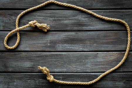 rope frame on wooden background top view mock up.