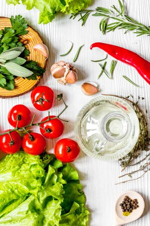 tomato with salad and garlic on wooden background top view 스톡 콘텐츠