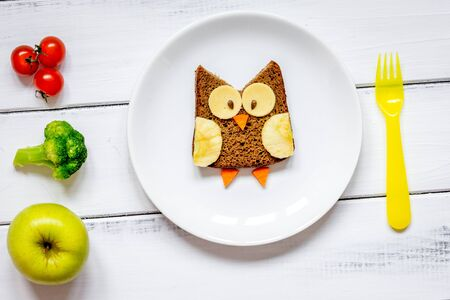 kids menu owl shaped sandwich with vegetables and fruits