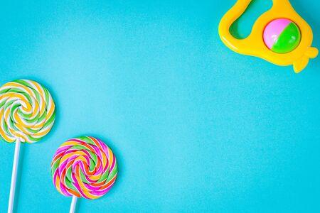 birth of child - lollipop on blue background top view Reklamní fotografie