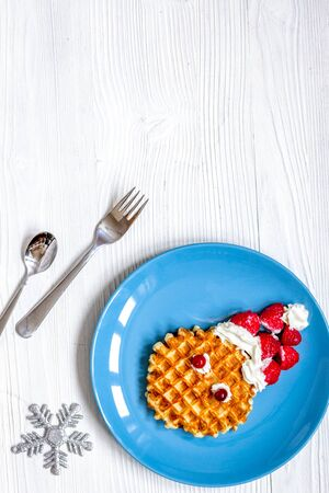 breakfast for child on Christmas with waffle top view on wooden background
