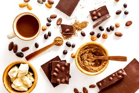 Cook homemade chocolate with bars, nuts, coffee beans on white background top view