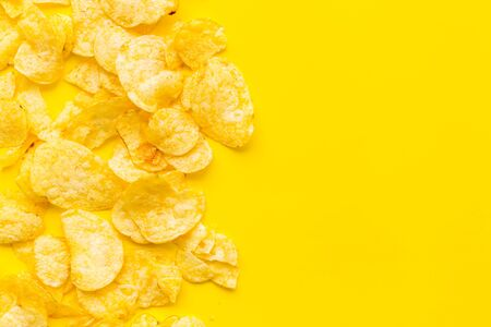 potato chips mock up on yellow background top view
