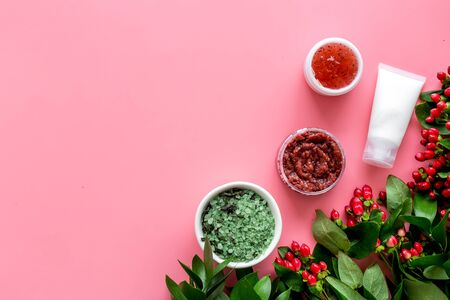 Cosmetics for face with cream, scrub, salt from herbs and berries on pink background top view copyspace Archivio Fotografico - 129423726