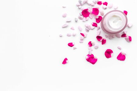 Cosmetics with sea salt and roses decoration on white background top view space for text Archivio Fotografico - 129423808