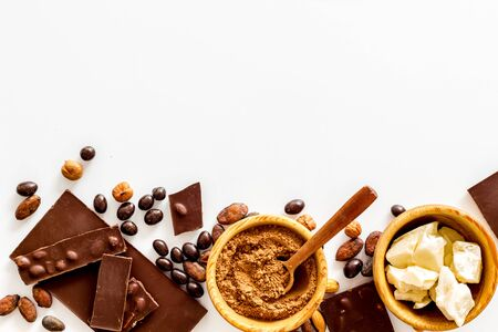 Chocolate with nuts and its ingredients on white background top view copyspace Zdjęcie Seryjne