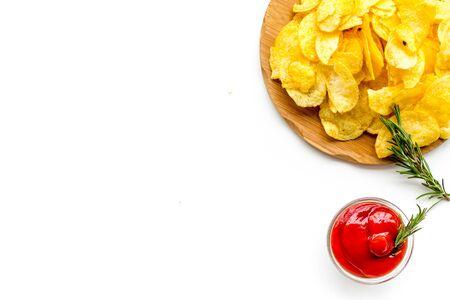 Potato crisps with tomato sauce on white background top view mockup