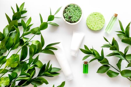 organic cosmetic with herbs on white background top view Archivio Fotografico - 129423960