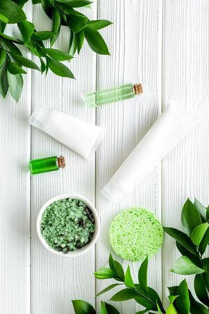 homemade spa with cosmetic from herbs on white wooden background top view Archivio Fotografico - 129424026