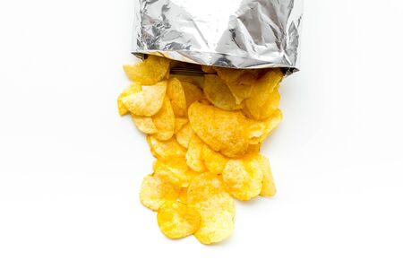 Junk food concept with potato crisps in bag on white background top view Stockfoto