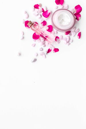 little stones and rose cosmetics mock up on white background top view