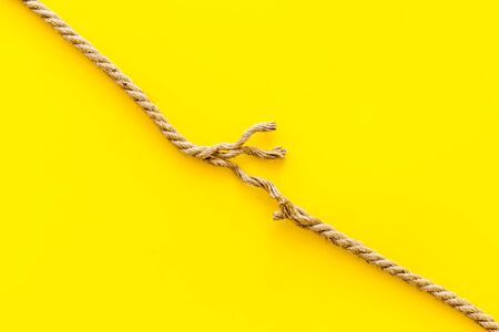stress concept with breaking rope on yellow background top view mock-up