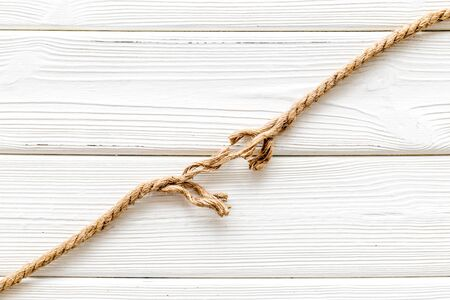 stress concept with breaking rope on white wooden background top view mockup