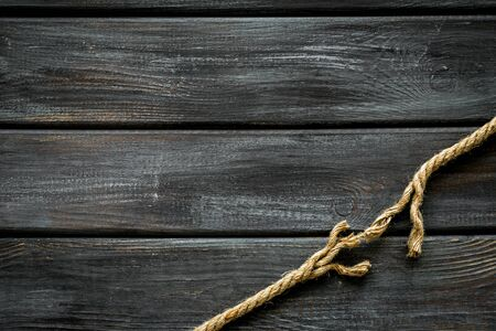 risk concept with rope near to break on wooden background top view space for text