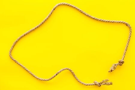 rope frame on yellow background top view mock up 写真素材