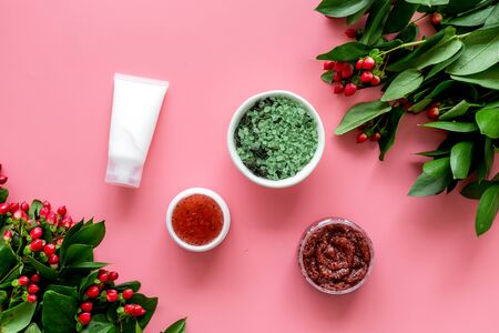 skin care with natural cosmetics with herbal extract on pinnk background top view