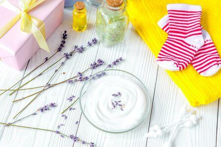 baby organic cream with lavender on shelf in bathroom