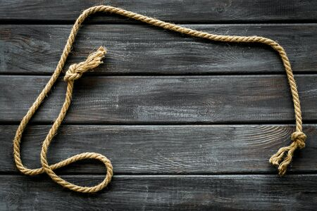 rope frame on wooden background top view mock up 写真素材