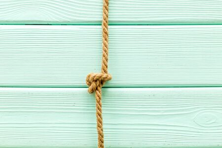 isolated rope mock-up on mint green wooden background top view .