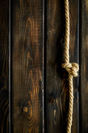 rope frame on wooden background top view mock-up.