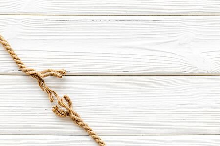 risk concept with rope near to break on white wooden background top view space for text. 写真素材