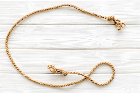 rope frame on white wooden background top view mock up.