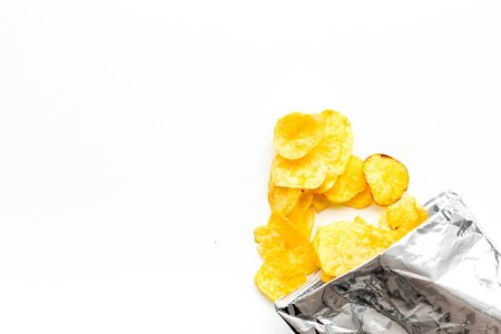 Junk food concept with potato crisps in bag on white background top view space for text