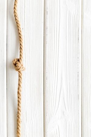 rope frame on white wooden background top view mock up