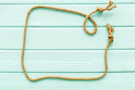 isolated rope mockup on mint green wooden background top view Reklamní fotografie