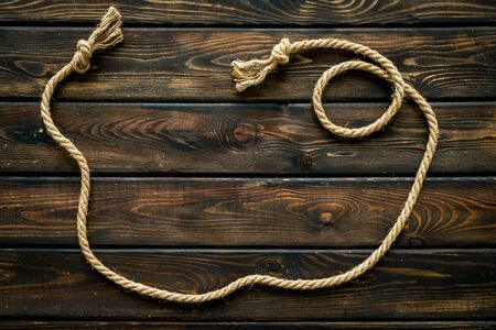 rope frame on wooden background top view mock-up