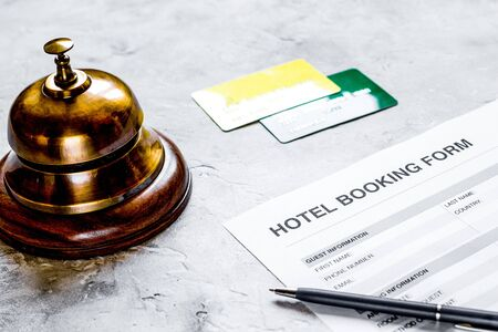 booking hotel room application form and ring stone desk background