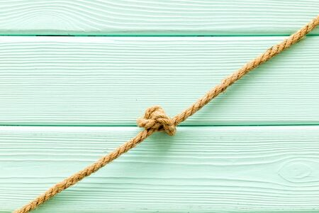isolated rope mockup on mint green wooden background top view Stock Photo