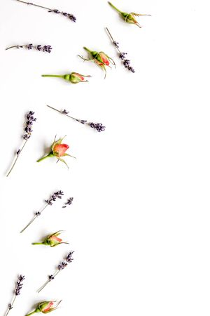 pattern of flowers on white background top view mock up. Standard-Bild - 133976525