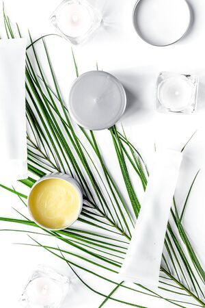 set of decorative cosmetics on wite table background top view