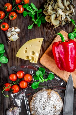 ingredients for vegetarian pizza on wooden table background top view