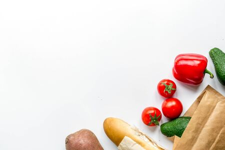 Store concept with vegetables, bread and paper bag on white table background top view mockup 写真素材
