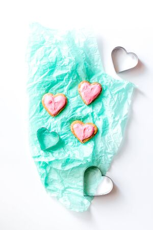 cookies for Valentines Day heartshaped on white background top view