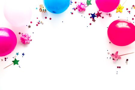 Party concept. Colorful balloons and confetti on white background top-down. Фото со стока