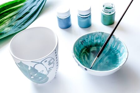 painted ceramic cup on white background close up Imagens