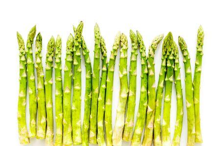 Fresh raw asparagus on white background top-down